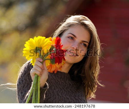 young pretty woman portrait outdoor in autumn
