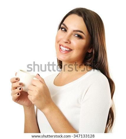 Young pretty woman poses with cup of coffee isolated on white background - stock photo