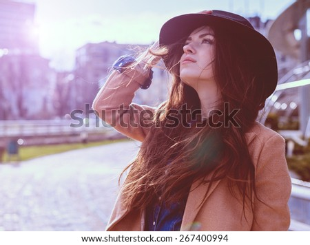 Young pretty woman posing in hat - stock photo