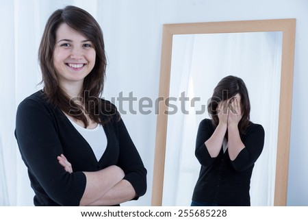 Young pretty woman pretending to be happy - stock photo