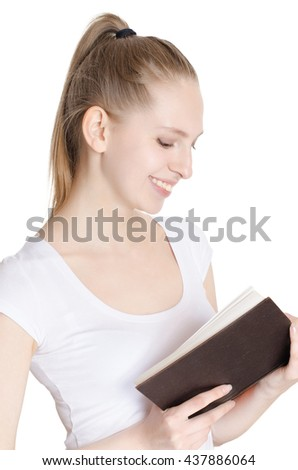 Young pretty woman reading a book on white background