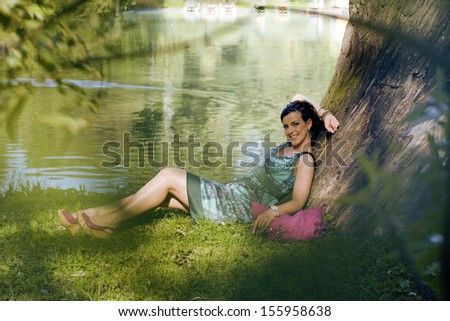 young pretty woman resting in green park