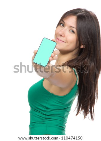 Young Pretty Woman Showing display of her new touch mobile cell phone. Focus on the hand and phone - stock photo
