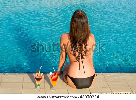 young pretty woman sitting in a swimming pool
