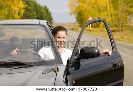 young pretty woman sitting in her car