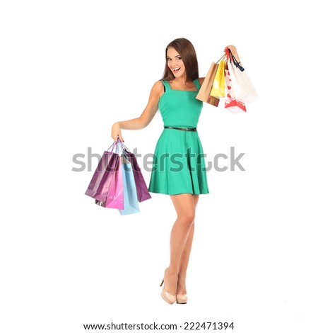 young pretty woman standing with colorfull shopping bags, studio