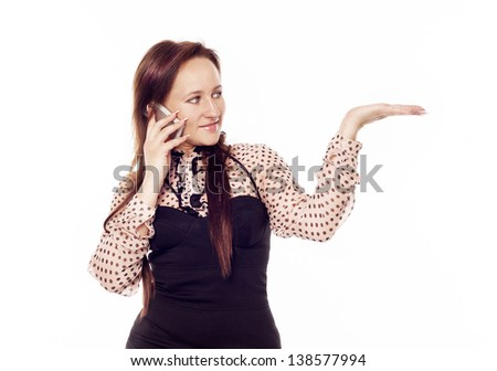 Young pretty woman talking on the phone - stock photo