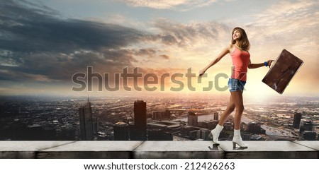 Young pretty woman tourist walking with suitcase