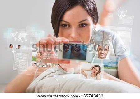 Young pretty woman using social media on her smartphone