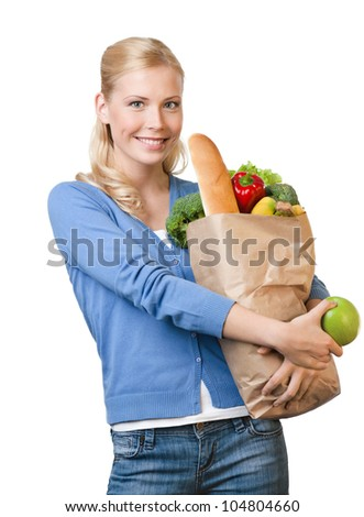 Young pretty woman with a paper bag full of healthy food, isolated on white