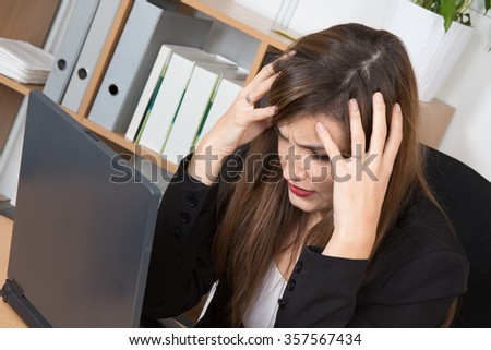 Young pretty woman with closed eyes and her covering ears .Do not wants listen other opinions and a lot of work concept - stock photo