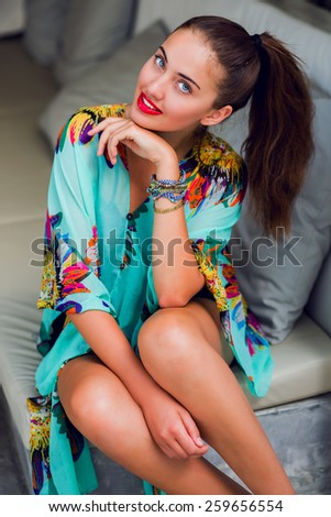 Young pretty woman with full red lips and big blue eyes  in colorful stylish  boho ethnic  beach dress  posing   in luxury spa . Traveling in  Thailand, Koh Samui .  - stock photo