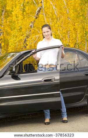 young pretty woman with her car