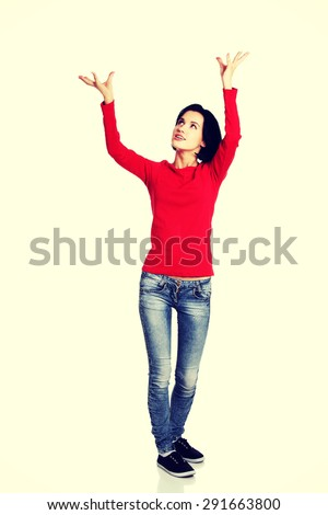 Young pretty woman with her hands up - stock photo