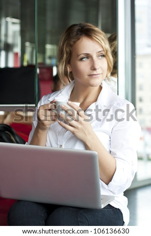Young pretty woman with laptop, indoors