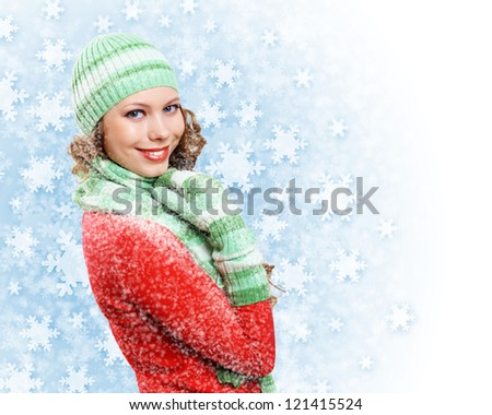 Young pretty woman with lomng hair wearing warm pullover - stock photo