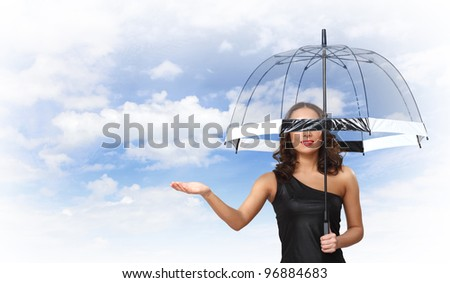 Young pretty woman with umbrella against sky background