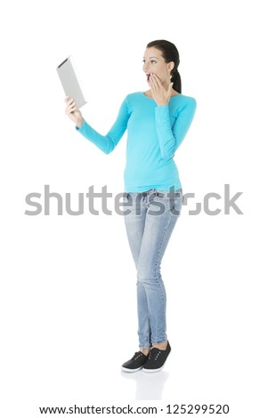 Young pretty woman working on tablet computer, isolated on white