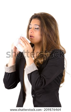 Young pretty working woman sneezing holding a tissue isolated on white - stock photo