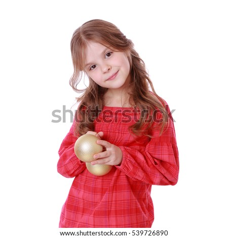young princess holding decorative golden ball for christmas tree on Holiday theme
