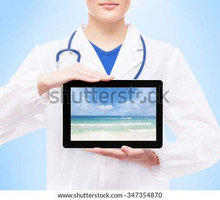 Young, professional and cheerful female doctor isolated on white suggesting holidays via tablet. - stock photo
