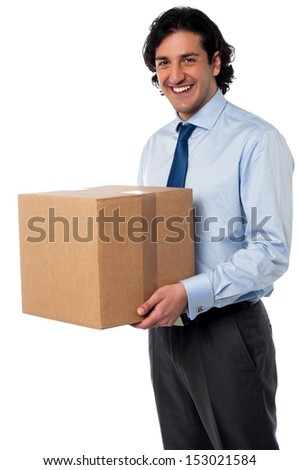 Young professional carrying heavy carton - stock photo