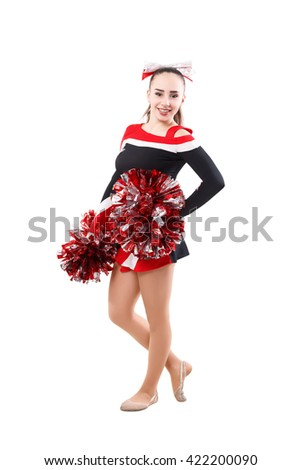 young professional cheerleader with pom-pom in your hand posing at studio. Isolated over white. - stock photo