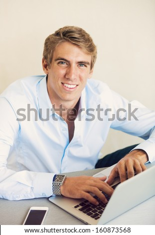 Young Professional, Handsome Man Working on Laptop Computer