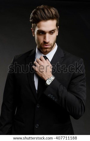 Young Professional Holding Tie