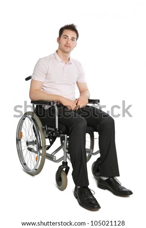 Young professional looking into camera isolated on white with wheelchair - stock photo