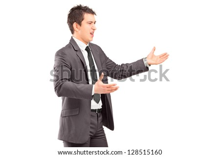 Young professional man in a suit arguing isolated on white background - stock photo
