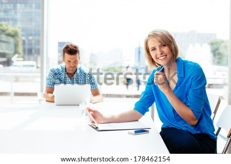 Young professional noting some ideas - stock photo