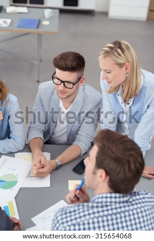 Young Professional People Having a Business Meeting Using Charts Inside the Boardroom at the Office. - stock photo