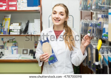 Young professional physician offering orthopaedic insoles in special shop