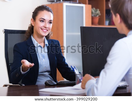 Young professional teaching new assistant in practice at company - stock photo