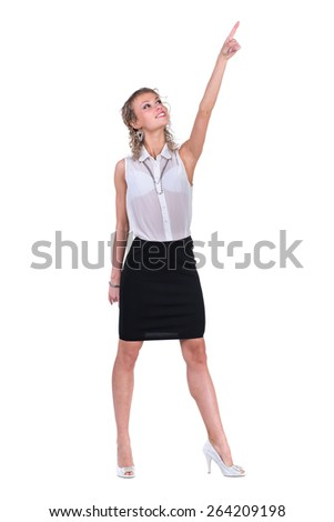 Young professional woman, pointing upwards. Caucasian businesswoman isolated on white background in full body - stock photo