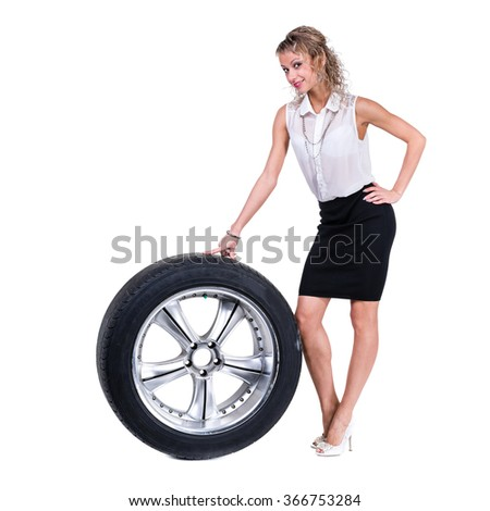 Young professional woman with car wheels. Caucasian businesswoman isolated on white background - stock photo