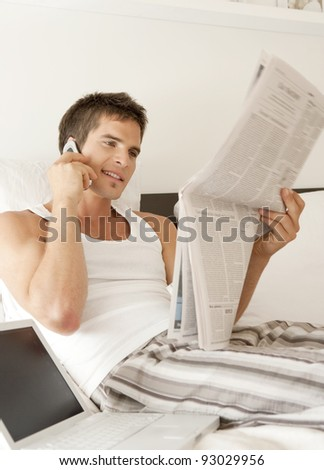 Young professional working from home in bedroom. - stock photo
