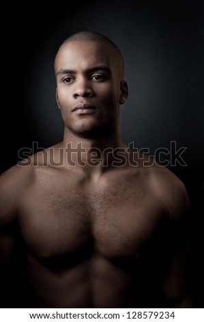 young purposeful black athlete holding basketball ball isolated on gradient gray background - stock photo