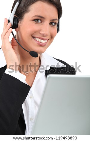 Young receptionist with headset - stock photo