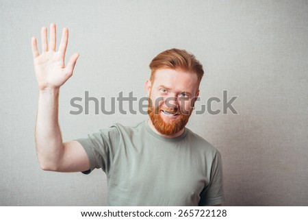 Young red bearded Man saluting - stock photo
