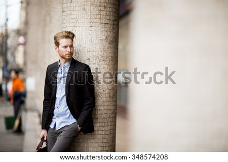 Young red hair man outdoors