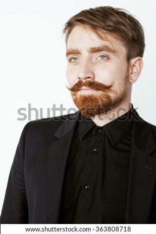 young red hair man with beard and mustache in black suit on white background - stock photo