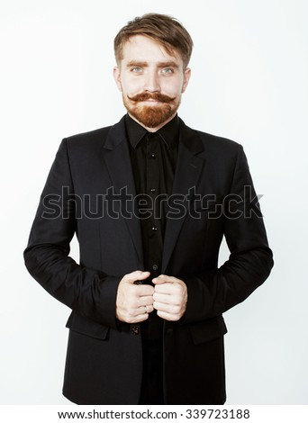 young red hair man with beard and mustache in black suit on white background close up - stock photo