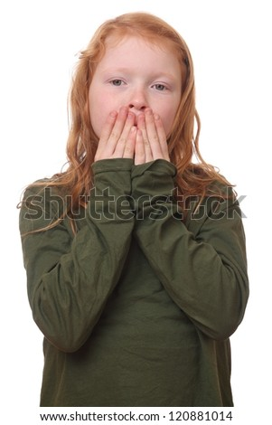 Young red haired girl covers her mouth on white background - stock photo