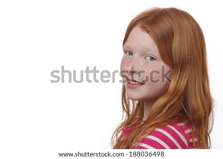 Young red-haired girl with freckles on white background - stock photo
