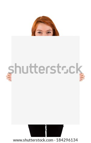 Young red head woman holding and showing blank, white advertisement board for your design, isolated on white background. - stock photo