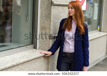 Young red woman walking and resting in the city