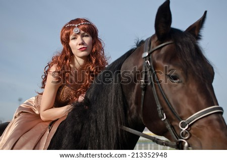 Young redhead girl and horse from fairy tale.