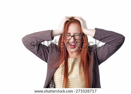 Young redhead screaming business woman with headache holding her hand to the head. Concept of problems and headache. Isolated on white background